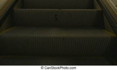 Move the steps up the escalator. An empty shopping center,...