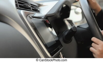 Close up shot hand of woman using touch screen in car...
