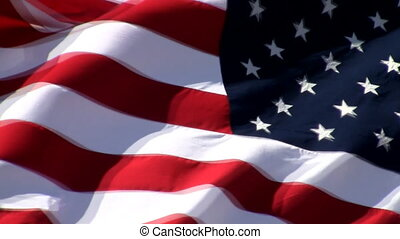 American flag waving with a strong wind