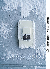 Close-up Doorbell Button cover with white snow . - Close-up...