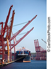 container cargo ship in port - cargo ship in port - large...