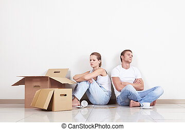 Quarrel - Young Couple with boxes and broken cup
