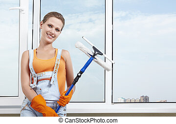 Cleanness - An attractive girl with a mop for washing...