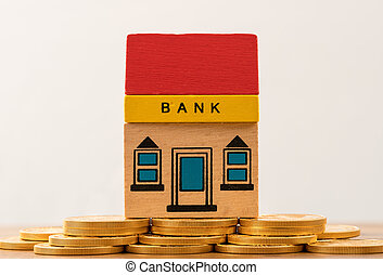 Toy bank building on gold coin assets - Toy brick bank...