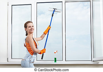 Window washing - The girl washing windows mop for washing...