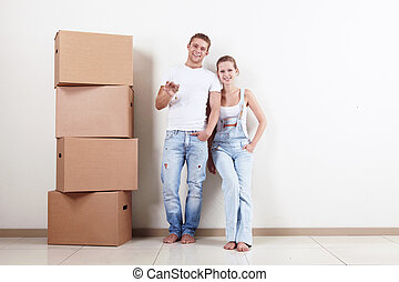 Happy owners of apartments - Young couple with boxes and...