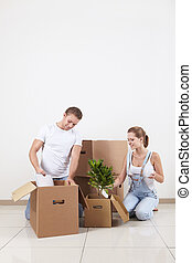Unpack - Young attractive couple unpacked