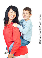 Happy mother and son in piggy back - Happy mother and son...