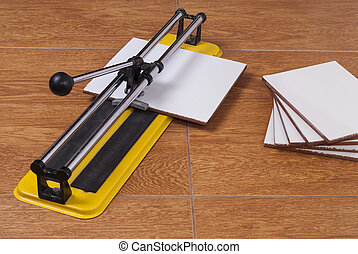 tile cutter on the floor - tile cutter and parts of the...