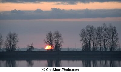 Timelapse of gorgeous sunrise over lake or river - Time...