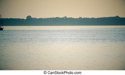 Time lapse of sail boat far off on lake or river - Time...