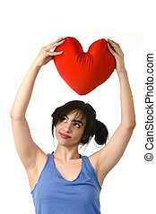 beautiful woman smiling happy feeling in love holding red heart shape pillow