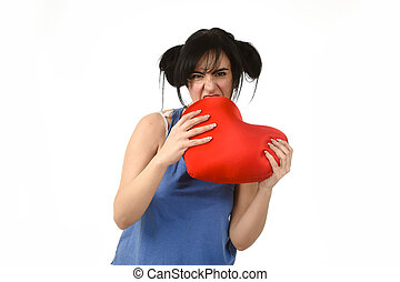 woman biting in rage spiteful and resentful a red heart...
