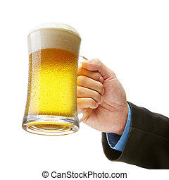 business success! - hand of a businessman holding a beer...