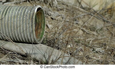 Industrial Mining Abandoned Suction Hose - An abandoned...