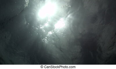 Sunlight through the surface of the water bottom view in sea.