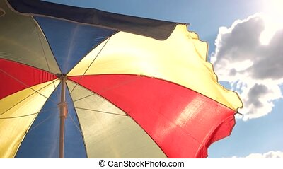 Beautiful multi-colored beach umbrella. - Beautiful...