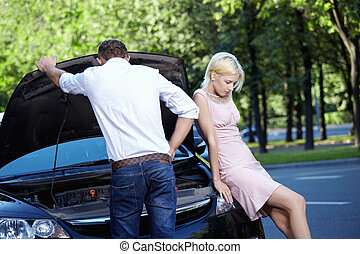 Accident situation - Young couple in a broken car