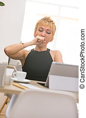 Beautiful business woman working in cafe - tired woman...