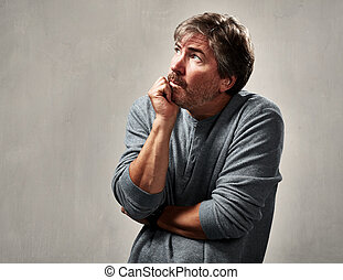 Anxious insecure man - insecure worried mature man portrait...