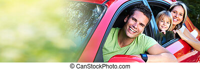 Family in red car - Happy family with kid in red car. Summer...