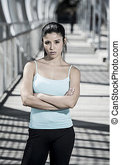 attractive hispanic brunette woman looking cool and defiant...