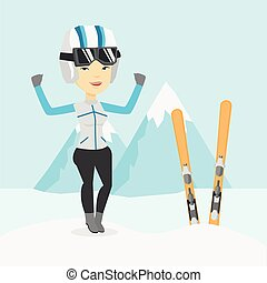 Cheerful skier standing with raised hands. - Asian...
