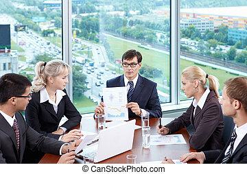 The meeting - The chief of staff at a meeting in the office
