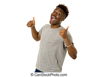 young friendly and happy afro american man smiling excited...