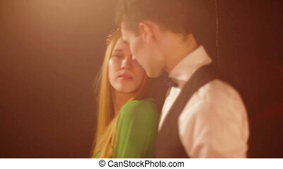 Happy and attractive young couple dance together