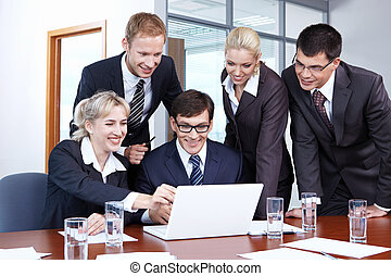 Employees in the office - Young employees working in the...