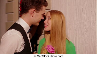 Young man gives pink rose her girlfriend - Charming couple,...