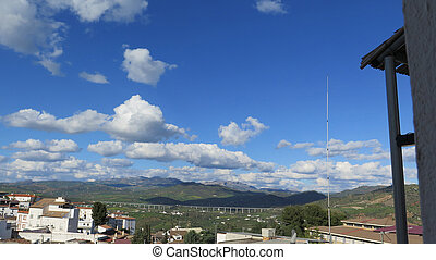 View of El Torcal mountain on sunny day with large clouds...