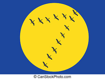 Migratory birds - A flock of birds flying across the sky in...