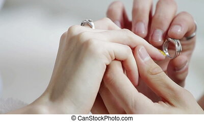 Young man romantically proposing to girlfriend and offering...