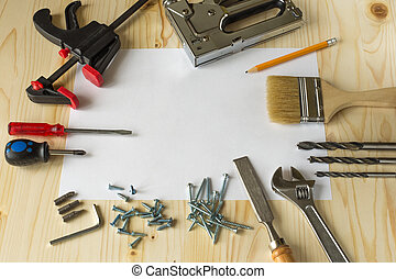 Tools for repairs in the house on a wooden table. Screws,...