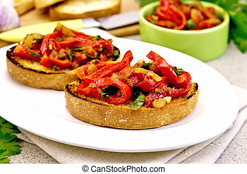 Bruschetta with vegetables in plate on granite table -...