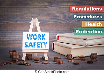 Work Safety Business Concept. Miniature easel with small...