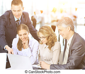 Business meeting - the manager discusses work with his colleagues but the background of the work of the business team