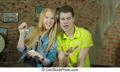 Happy and attractive young couple dance together - Happy and...