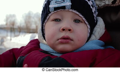 Face of a small boy with very expressive eyes in winter...