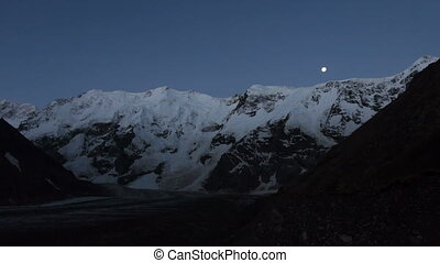 Mountains moon and sunrise - Elbrus area. Time-lapse -...