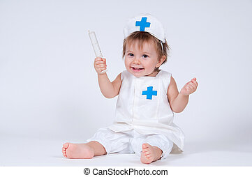 Cheerful girl child playing as a doctor with a syringe