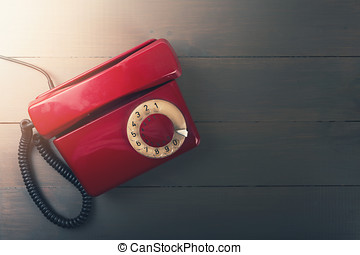old red phone on wooden table with copy space