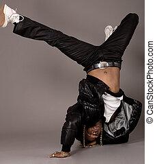 African american doing break dance on grey background