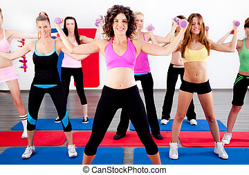 women doing aerobics with dumbbell - image of women doing...