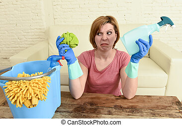 woman cleaning living room table with cloth and spray bottle...