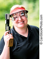 Portrait of smiling woman on sport shooting training