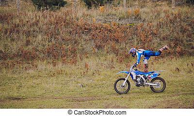MX moto woman Biker shows acrobatic at cross racing - rider...