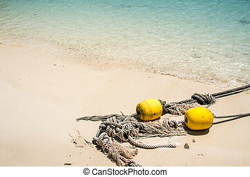old rope with bouy recue ocean - old rope with yellow...